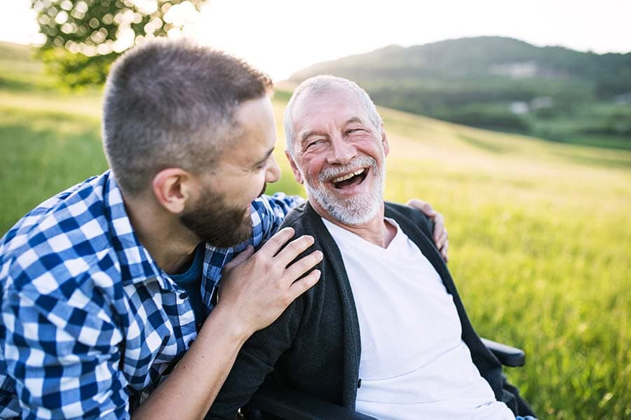 carer on a walk with elderly man
